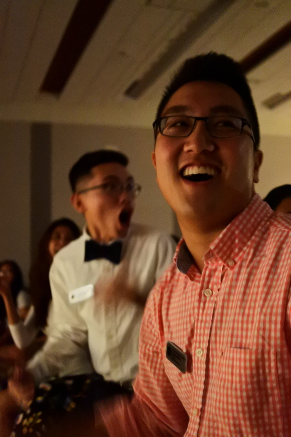 """AASU President Kevin Doan, right, and Biology Freshman Tuan Nguyen react to not winning the Beque Holic drawing. """"I love the roller coaster experience of almost winning something,"""" Doan said. Photo by Royce Abela."""